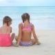 Adorable Little Girls Playing with Sand on the Beach - VideoHive Item for Sale