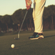 golfer  hitting shot at golf course - PhotoDune Item for Sale