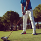 golf player placing ball on tee - PhotoDune Item for Sale