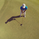top view of golf player hitting shot - PhotoDune Item for Sale