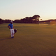 golfer  walking and carrying golf  bag at beautiful sunset - PhotoDune Item for Sale