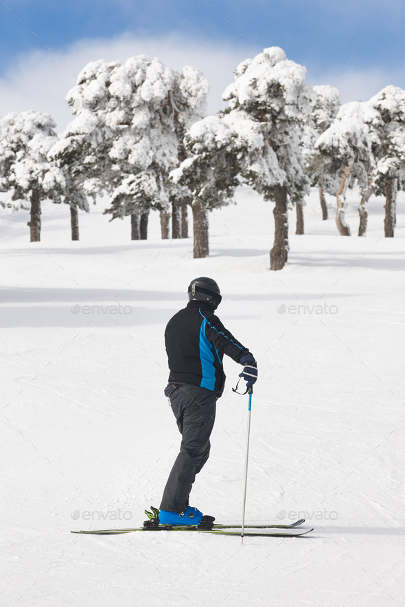 Skier on snowy forest slope. White mountain landscape. Winter sport - Stock Photo - Images