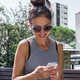 Young woman and her smartphone. - PhotoDune Item for Sale