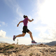 Successful woman trail running on mountain top - PhotoDune Item for Sale