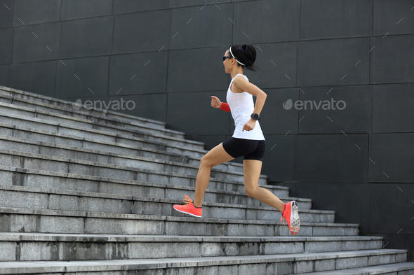 Runner running up on city stairs - Stock Photo - Images