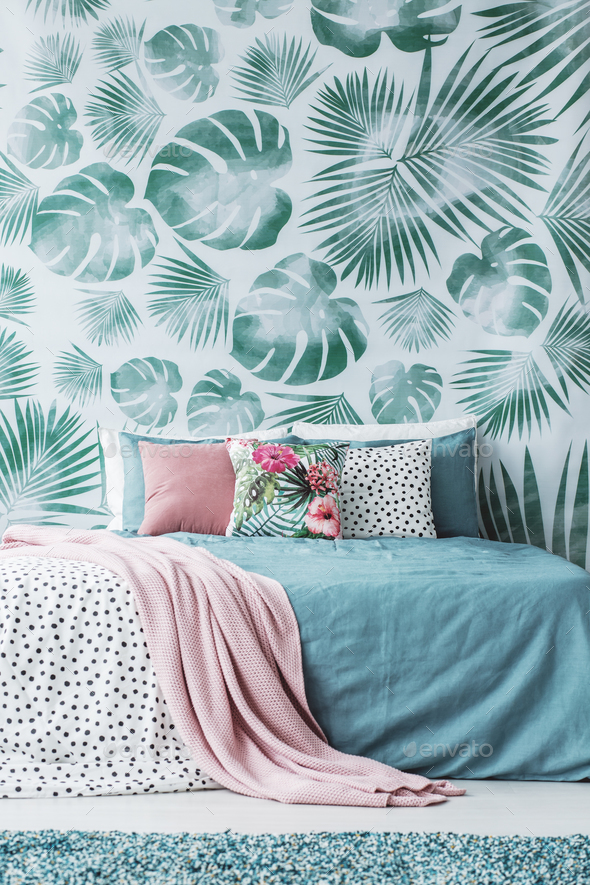 Turquoise bed by leaves wallpaper