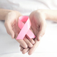 Pink ribbon in hands - PhotoDune Item for Sale