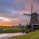 Three windmills in a row under beautiful sunset - PhotoDune Item for Sale