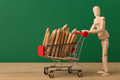 Wooden mannequin with miniature shopping cart - PhotoDune Item for Sale