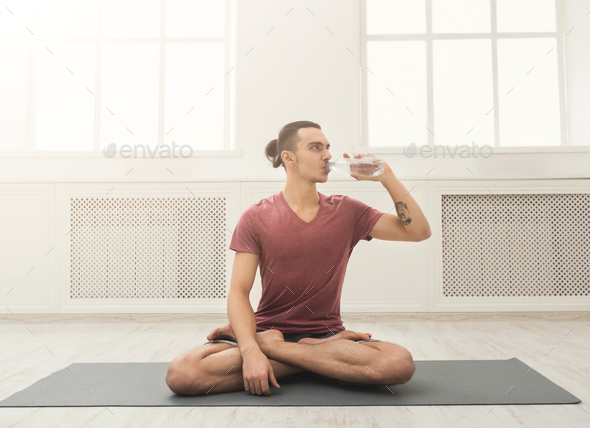 Fitness man drinking water at gym - Stock Photo - Images