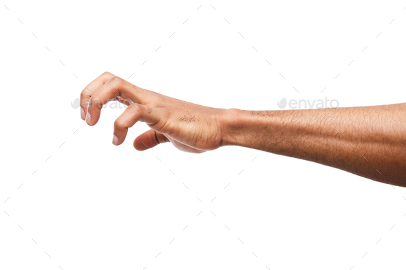 Male hand picking up something, cutout - Stock Photo - Images