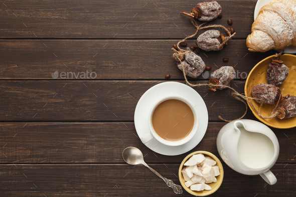 Coffee cup and sweets on vintage wooden table, top view - Stock Photo - Images