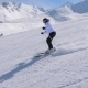 Sporty Woman Skier Professionally Carving Down The Slope In The Mountains - VideoHive Item for Sale