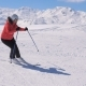 Woman Skis Carving Down The Slope In The Mountains Ski Resort At Winter - VideoHive Item for Sale
