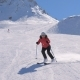 Sporty Woman Skis Carving Down The Slope In The Mountains Ski Resort At Winter - VideoHive Item for Sale