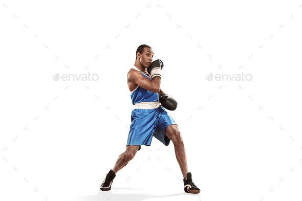 Sporty man during boxing exercise making hit. Photo of boxer on white background - Stock Photo - Images