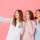 Picture of three cute women 20s wearing colorful striped pyjamas - PhotoDune Item for Sale
