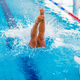 Female swimmer jumping in to the pool - PhotoDune Item for Sale