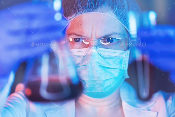 Scientist working with chemicals in laboratory - Stock Photo - Images