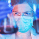 Scientist working with chemicals in laboratory - PhotoDune Item for Sale