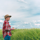 Farmer using digital tablet in wheat crop field - PhotoDune Item for Sale