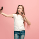 The happy teen girl making selfie photo by mobile phone - PhotoDune Item for Sale
