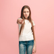 The happy teen girl pointing to you, half length closeup portrait on pink background. - PhotoDune Item for Sale