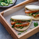 Bao buns with cucumber salad, close view. - PhotoDune Item for Sale
