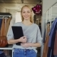 Free Download Portrait of Successful Young Businesswoman Standing in Her Clothing Store, Holding Tablet Nulled