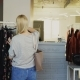 Free Download Young Woman Stealing Wallet From Female Customer Choosing Clothes in Shop. Thief Looking Around Nulled