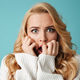 Close up portrait of a shocked young blonde woman - PhotoDune Item for Sale