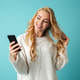 Portrait of a joyful young blonde woman in sweater - PhotoDune Item for Sale
