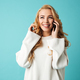 Portrait of a smiling young blonde woman in sweater - PhotoDune Item for Sale