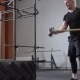 Male Athlete Doing Sledgehammer Swing Exercise in Cross Fit Gym - VideoHive Item for Sale