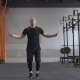 Fitness Man Doing Double Jumps Rope Exercise in Gym - VideoHive Item for Sale