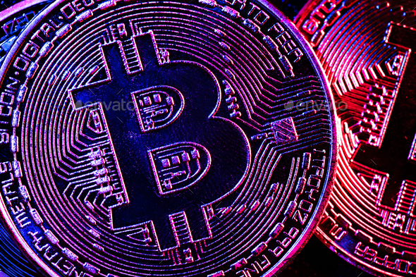 Bitcoin coins in a mysterious lighting - Stock Photo - Images