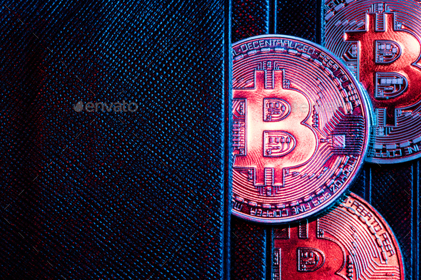 Bitcoin coins sticking out of a wallet. - Stock Photo - Images