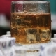 Whiskey in a Glass of Ice on a Black Background - VideoHive Item for Sale