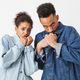 Scared african couple in denim shirts covering their mouths - PhotoDune Item for Sale