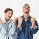 Cheereful african couple in denim shirts rejoices and screaming together - PhotoDune Item for Sale
