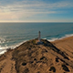 Aerial View of Lighthouse on the Coast during Sunset  - VideoHive Item for Sale