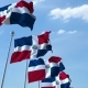 Waving Flags of the Dominican Republic Against the Sky - VideoHive Item for Sale