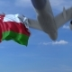 Commercial Airplane Flying Above Waving Flag of Oman - VideoHive Item for Sale