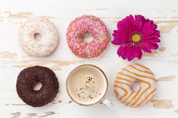 Coffee cup, donuts and gerbera flower - Stock Photo - Images