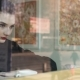 Young Woman Working Very Concentrated with Her Laptop Next To the Window in a Coffee Shop - VideoHive Item for Sale