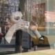 Young Woman Working with Her Laptop Next To the Window in a Coffee Shop - VideoHive Item for Sale