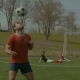 Young Footballer Heading Soccer Ball on the Field - VideoHive Item for Sale