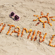 Sunglasses, inscription vitamin D and shape of sun on sand at beach - PhotoDune Item for Sale