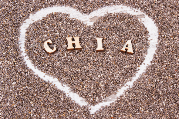 Heart shaped chia seeds as source natural vitamins, dietary fiber and minerals - Stock Photo - Images