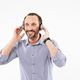 Handsome smiling adult man listening music with headphones - PhotoDune Item for Sale